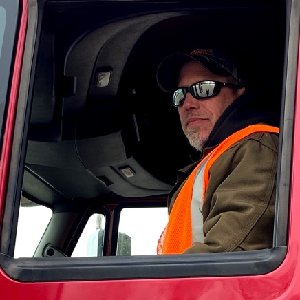 Driver sitting in red truck